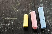 Colorful Chalks On Blackboard