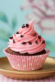 picture of cupcakes  - Pink cupcake decorated with tiny chocolate stars - JPG