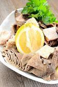 image of tripe  - entrails of stomach of beef cooked in salted water with lemon juice called trippa tripe - JPG