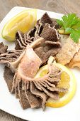 stock photo of tripe  - entrails of stomach of beef cooked in salted water with lemon juice called trippa tripe - JPG