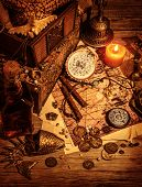Pirates treasure still life on wooden table, luxury medieval things background, stolen money and jew