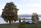 image of caravan  - Campsites by a lake in autumn - JPG