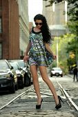 Young brunette model posing on the street
