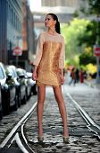 Fashion model posing in designer dress
