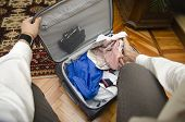 Self Point Of View Of Man Packing Suitcase