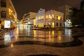 MACAU, CHINA - OCTOBER 30, 2012: Night view in rain on the Historic Centre of Macao - Senado Square. The Historic Centre of Macao was inscribed on the UNESCO World Heritage List in 2005.