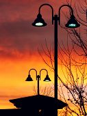 Lit Vertical Lightposts With Sunrise Background