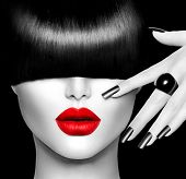 Black and White High Fashion Model Girl Portrait with Trendy Hair style, Make up and Manicure. Long Black Fringe Hairstyle, Black Matte Nail Polish and Red Lipstick. Woman Makeup. Sexy Lips. Haircut