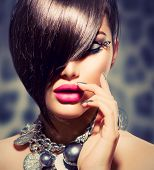 Hairstyle. Fringe. Haircut. Beauty Sexy Model Girl Portrait with Perfect Makeup and Manicure. Healthy Smooth Skin. Make up. Diamond Collar Accessories. False Eyelashes
