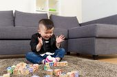 Little boy feeling excited to play toy block