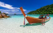 stock photo of aquamarine  - Long tail boat on white sand beach on tropical island Koh Lipe Andaman sea Thailand - JPG