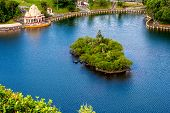 Island With Tropical Greenery In The Blue Lake