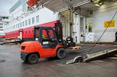 picture of truck-cabin  - Big passenger ferry loading with lift truck - JPG