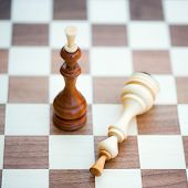 Two Chess Pieces Alone On A Chess Board