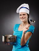Cheerful Woman Cook Holding A Pot And A Soup Ladle