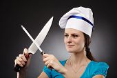 Woman Chef Sharpening The Knife