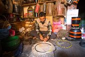BHAKTAPUR, NEPAL - DEC 19: Unidentified master makes drums in his workshop, Dec 19, 2013 in Bhaktapur, Nepal. 100 cultural groups have created an image Bhaktapur as Capital of Nepal Arts.
