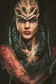 picture of sting  - Young woman with spider body art and mask - JPG