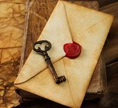Book, old key and envelope on vintage blank paper