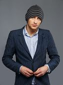 stock photo of beanie hat  - Stylish young man in jacket and beanie hat - JPG