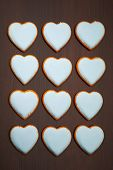 multitude of cookies hearts on brown background