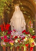 Virgin Mary Statue with Flowers Garden Mission San Buenaventura Ventura California