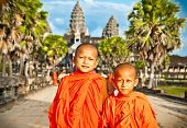 ANGKOR WAT, CAMBODIA - NOV 20,2013: unidentified Buddhist monks in Angkor Wat complex on Nov 20, 201