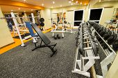 stock photo of light weight  - Interior view of a gym with equipment and weights - JPG