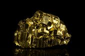foto of pyrite  - pyrite mineral stone with a black background - JPG
