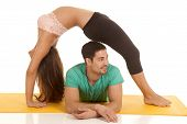 Fitness Couple Backbend Over Him Look Side