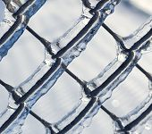 Ice coated chain link fence from an ice storm