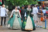 MUSKOGEE, OK - MAY 24: Women dressed in historical costume walk around the village at the Oklahoma 1