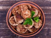 stock photo of pork cutlet  - Fried cutlet in the plate on wooden table - JPG