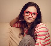 Happy Girl Sitting On Sofa And Looking In Fashion Red Glasses. Vintage Portrait
