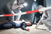 foto of murders  - Murder scene with two forensic analysts and a police lieutenant investigating a crime on a businessman in a basementMurder scene with two forensic analysts and a police lieutenant investigating a crime on a businessman in a basement - JPG