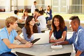 stock photo of 16 year old  - High School Students Hanging Out On Campus - JPG