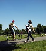 Cyclist and mother with her baby in a park
