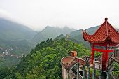 pic of shan  - photo of generic chinese landscape with red pavilion misty mountains and golden pagoda in the distance - JPG