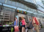 BERLIN, GERMANY - JUNE 11, 2014: Pedestrians walk past a Butlers home accessories store in  Berlin, Germany, on Saturday, June 11, 2014