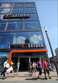 BERLIN, GERMANY - JUNE 11, 2014: Pedestrians walk past a Saturn consumer electronics store in  Berli