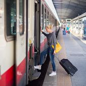 pic of passenger train  - Blonde casual caucasian lady traveling by train - JPG
