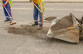 Worker Operating Asphalt During Road Works