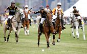 JERSEY CITY, NJ-MAY 31: Hilario Figueras (C) chases the ball during the polo match at the 7th Annual