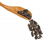 Chinese Tie Guan Yin Tea leaves in wooden scoop, Chinese famous oolong tea on white background