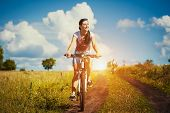 Young Woman is riding bicycle outside. Healthy Lifestyle