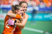 THE HAGUE, NETHERLANDS - JUNE 14: Dutch captain Maartje Paumen and Lidewij Welten hug after the fina