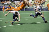 THE HAGUE, NETHERLANDS - JUNE 13: Dutch player Jolie is flying over English field player Lewers, aft