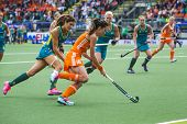 THE HAGUE, NETHERLANDS - JUNE 14: Dutch field hockey player Naomi van As rushes past Australian Anna