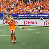 THE HAGUE, NETHERLANDS - JUNE 14: Dutch captain Maartje Paumen raises her fists after scoring a penalty push, giving Netherlands the lead in the finals of the World Cup Hockey against AUS in 2014