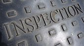 stock photo of manhole  - Inspection sign in metal manhole access cover - JPG